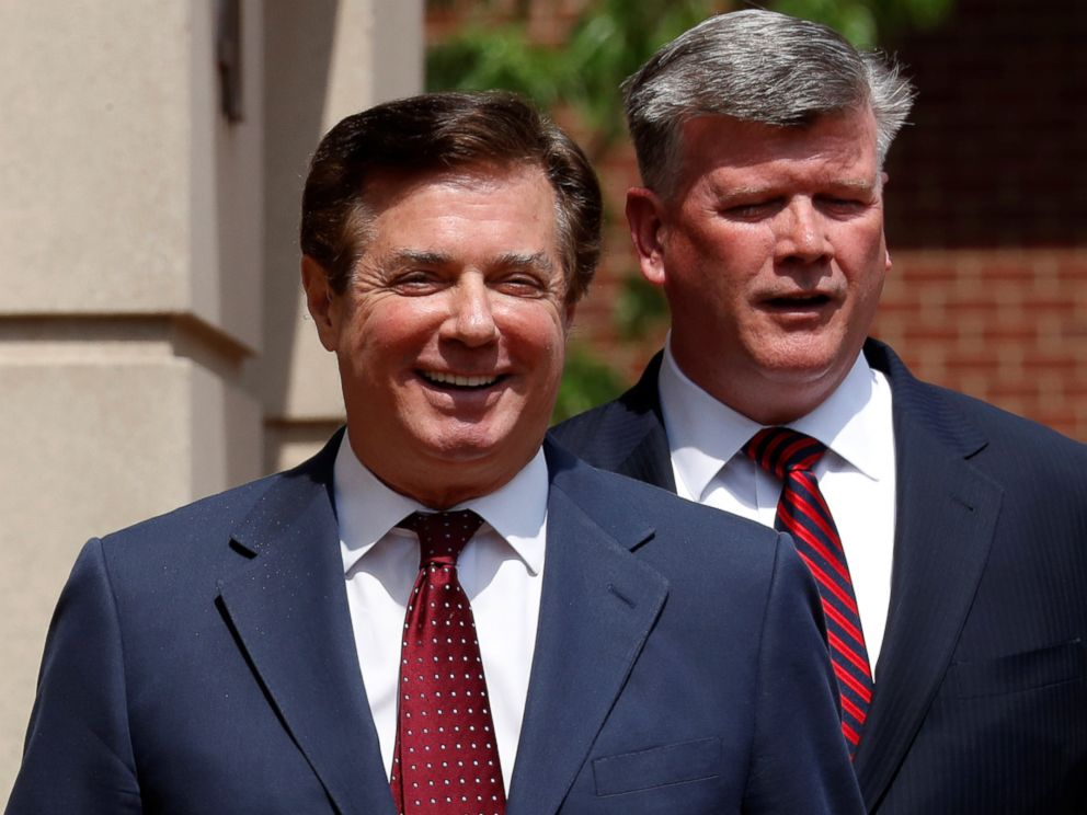PHOTO: President Trumps former campaign manager Paul Manafort smiles as he and his attorney Kevin Downing depart U.S. District Court after a motions hearing in Alexandria, Va., May 4, 2018.