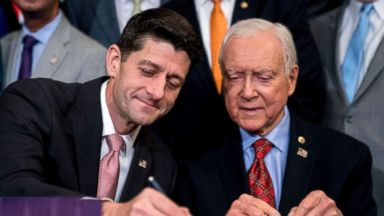 'PHOTO: Speaker of the House Paul Ryan accompanied by Senate Finance Committee Chairman Orrin Hatch, right, signs the final version of the GOP tax bill during an enrollment ceremony1_b@b_1the Capitol in Washington, Dec. 21, 2017.' from the web at 'https://s.abcnews.com/images/Politics/paul-ryan-tax-bill-ap-ml-171222_16x9t_384.jpg'