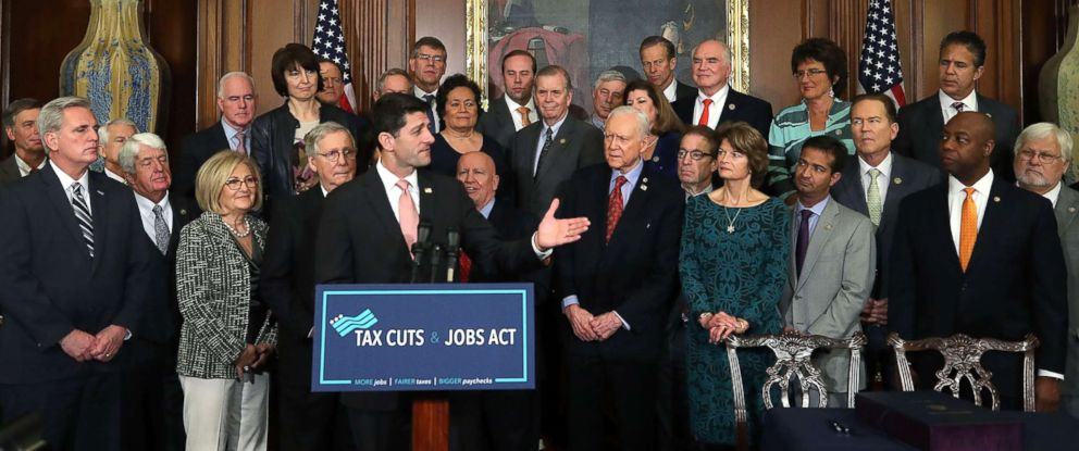 PHOTO: House Speaker Paul Ryan, flanked by Republican lawmakers, speaks during an enrollment ceremony for the conference report to H.R. 1, the Tax Cuts and Jobs Act. that was passed this week by the House and Senate, at the U.S. Capitol, Dec. 21, 2017.