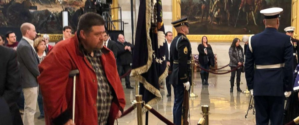 PHOTO: Paul Smith, left, traveled from Utah on Tuesday morning to see former President George H.W. Bush lying in state at the U.S. Capitol in Washington, Dec. 4, 2018.