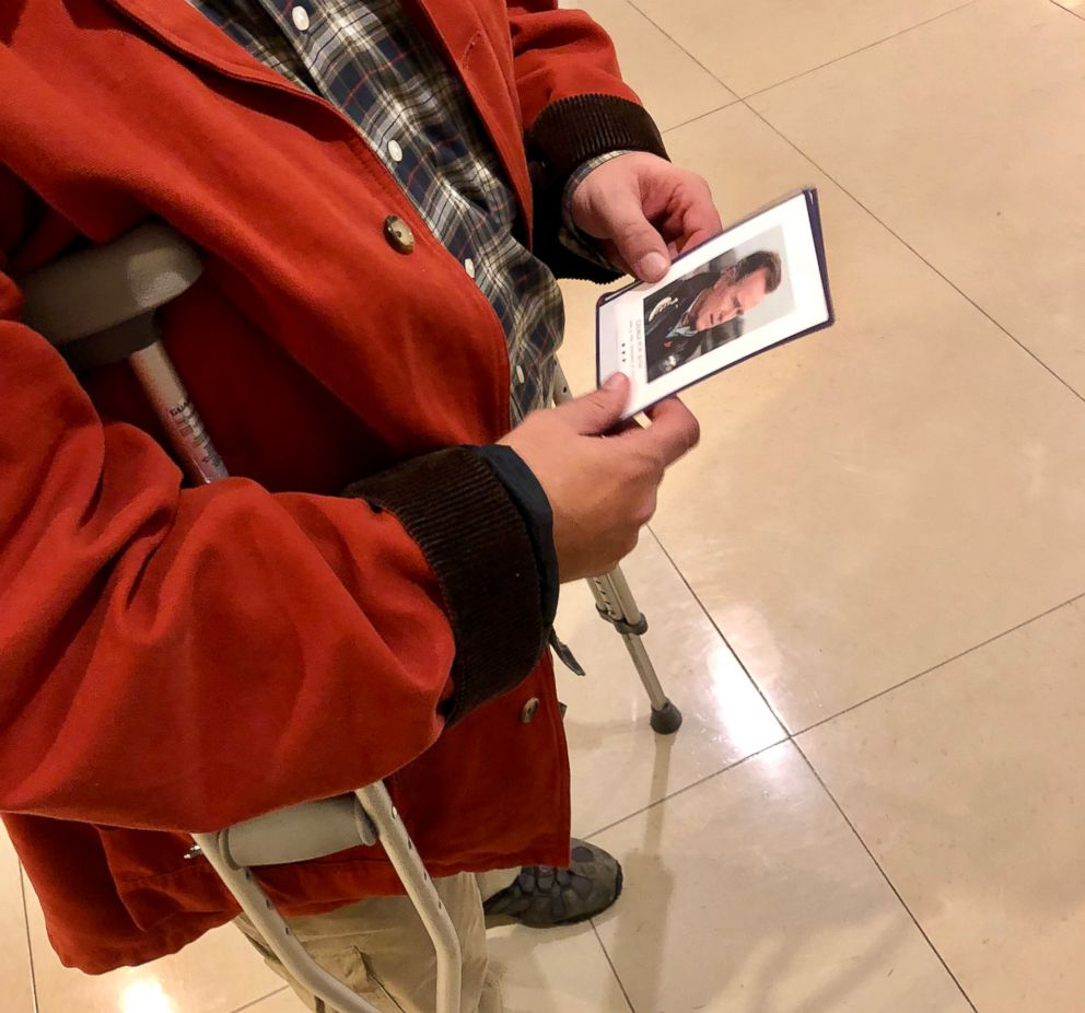 PHOTO: Paul Smith, 52, of Tooele, Utah, holds a remembrance card with a photo of President George H.W. Bush on Dec. 4, 2018. Smith flew in on a red-eye from Salt Lake City to see the former presidents casket in the U.S. Capitol.