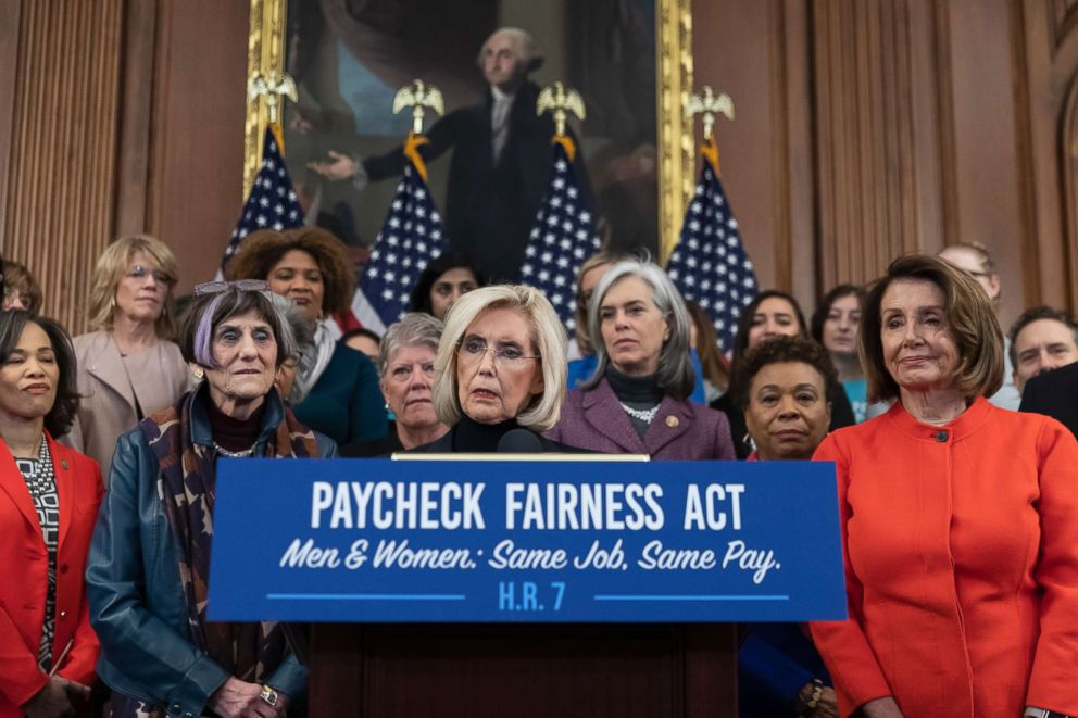 PHOTO: Lilly Ledbetter, center, an activist for workplace equality, is flanked by Speaker of the House Nancy Pelosi and Rep. Rosa DeLauro while she speaks at an event to advocate for the Paycheck Fairness Act at the Capitol in Washington, Jan. 30, 2019.
