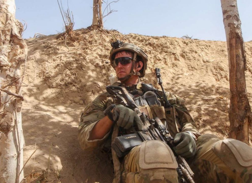 """PHOTO: Sgt. Maj. Thomas """"Patrick"""" Payne conducts a security patrol while on a mission in northern Afghanistan in 2014. Sgt. Maj. Payne will receive the Medal of Honor after risking his life to save hostages facing execution by ISIS in Iraq in 2015."""