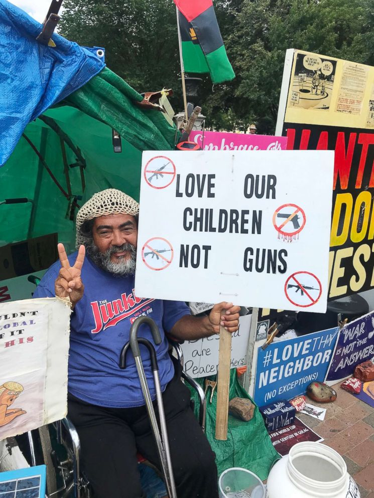 PHOTO: Philipos Melaku-Bello holds a sign in favor of gun control at the William Thomas Memorial Anti-Nuclear Peace Vigil in Washington on June 6, 2018.