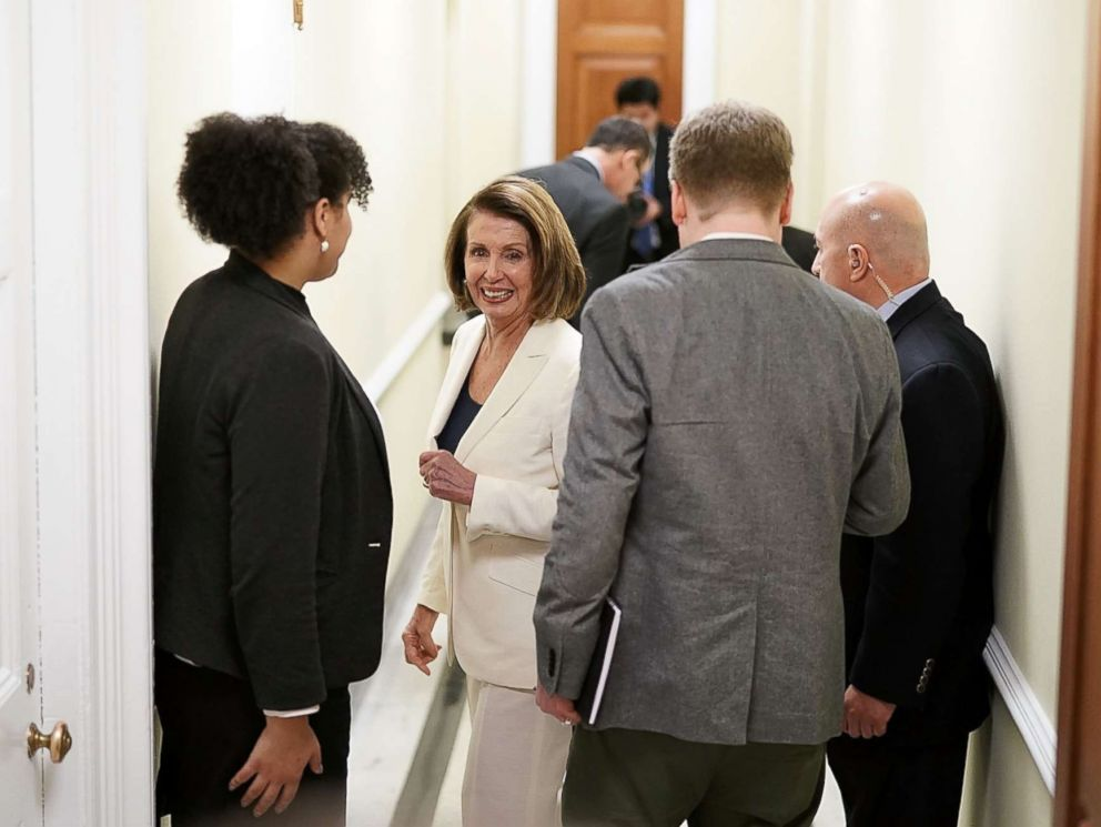 PHOTO: House Minority Leader Rep. Nancy Pelosi (D-CA) (C) on her way returns to her office after a long speech on immigration at the Capitol, Feb. 7, 2018.