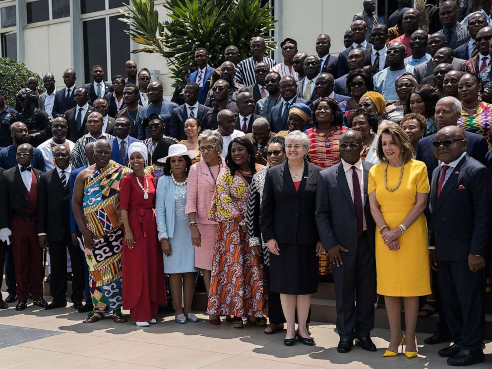 PHOTO: Speaker of the House Nancy Pelosi (2nd R), Speaker of Ghanas Parliament Mike Aaron Oquaye (R) and US Representative Ilhan Omar (5th L) pose for a family picture with members of Parliament in front of the Ghanas Parliament in Accra, July 31, 2019.
