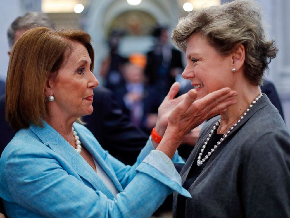PHOTO: Nancy Pelosi, left, greets journalist Cokie Roberts in the Great Hall of the Library of Congress in Washington, Sept. 14, 2016.