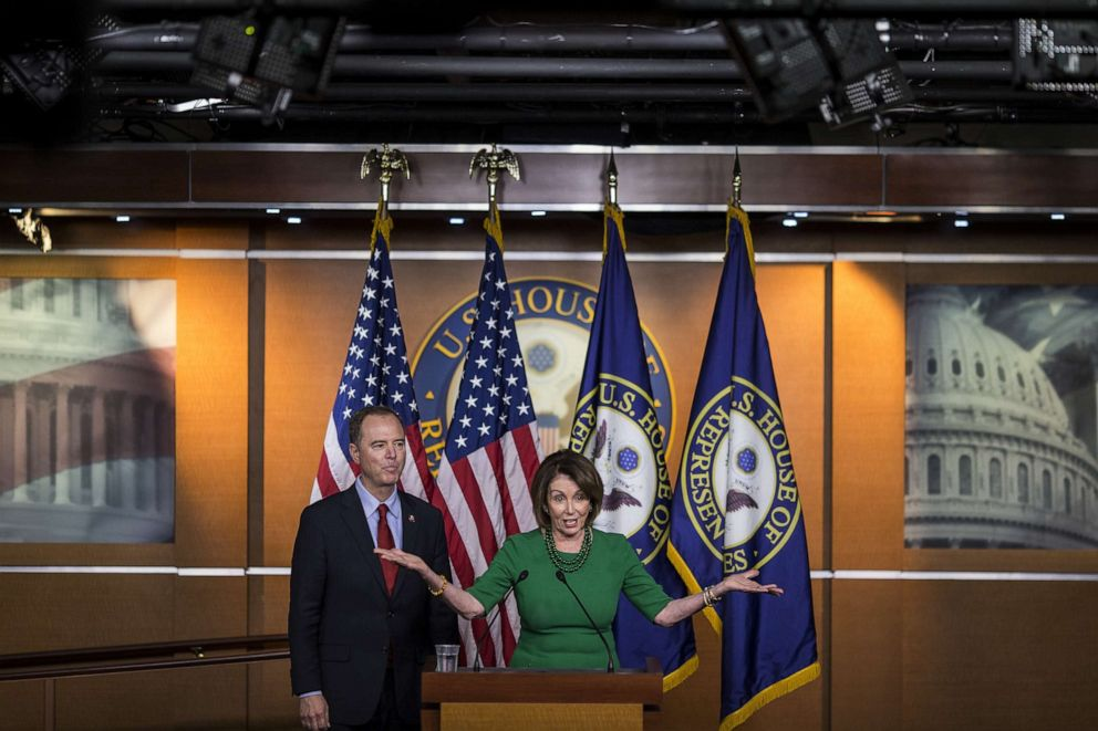 PHOTO: House Speaker Nancy Pelosi, D-CA, right, speaks while House Intelligence Committee Chairman Rep. Adam Schiff, D-CA, stands during a news conference on Capitol Hill on Oct. 15, 2019 in Washington, D.C.
