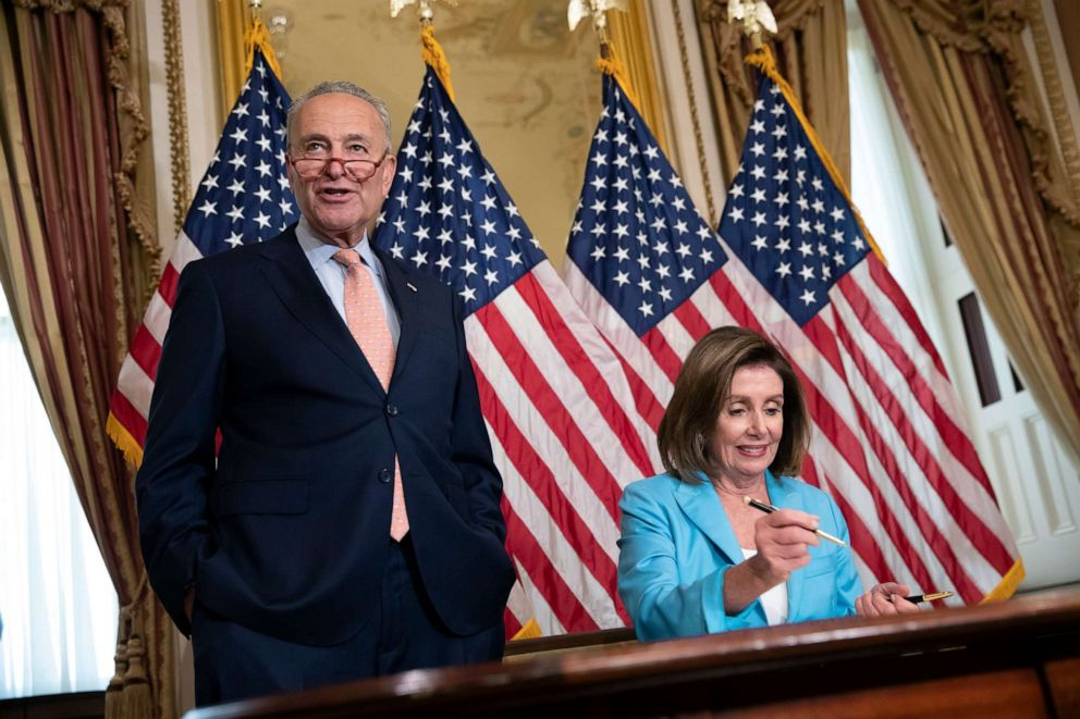 PHOTO: Senate Minority Leader Chuck Schumer joins Speaker of the House Nancy Pelosi as she signs the budget package at the Capitol in Washington, Aug. 1, 2019.