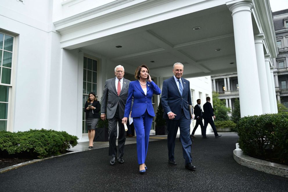 PHOTO: Speaker of the House Nancy Pelosi (C), Senate Minority Leader Chuck Schumer (D-NY) (R) and Representative Steny Hoyer, walk out of the White House after meeting with US President Donald Trump on Oct. 16, 2019.