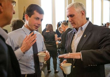 PHOTO: In this May 1, 2015, file photo, then-Indiana Gov. Mike Pence, right, talks with South Bend Mayor Pete Buttigieg during a visit to recap the legislative session that ends in South Bend.