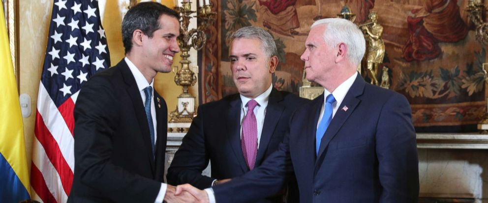 PHOTO: Venezuelas self-proclaimed interim president Juan Guaido, left, shakes with Vice President Mike Pence, after a meeting of the Lima Group concerning Venezuela at the Foreign Ministry in Bogota, Colombia, Monday, Feb. 25, 2019.