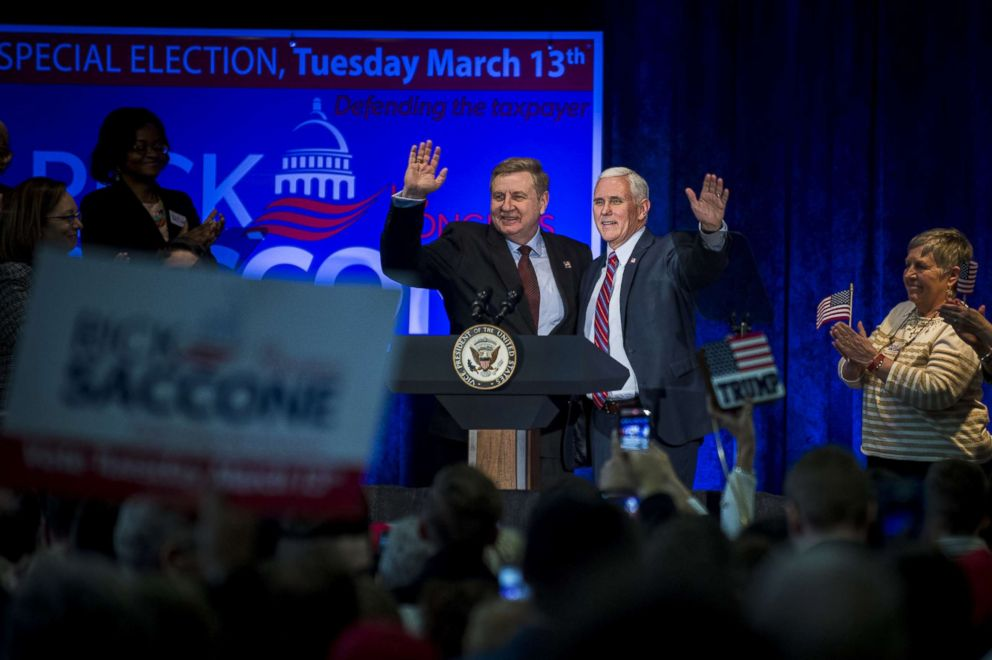 PHOTO: Republican Pennsylvania congressional candidate Rick Saccone and Vice President Mike Pence acknowledge the audience during a campaign event at the Bethel Park Community Center on Feb. 2, 2018 in Bethel Park, Penn.