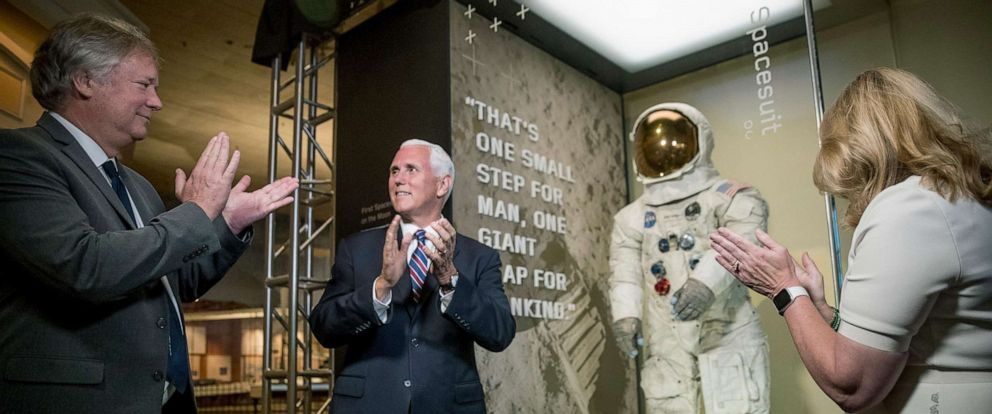 PHOTO: From left, Rick Armstrong, Vice President Mike Pence, and Smithsonians National Air and Space Museum Director Ellen Stofan, unveil Neil Armstrongs Apollo 11 spacesuit, July 16, 2019, in Washington, D.C.