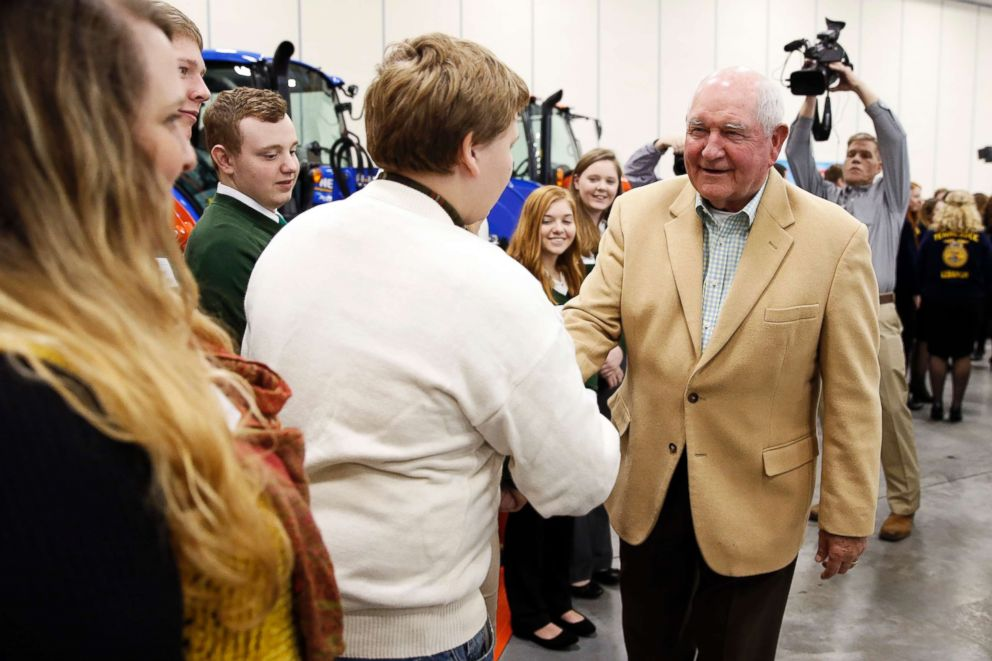 PHOTO: Agriculture Secretary Sonny Perdue, right, greets a youth group at the Wilson County Exposition Center Tuesday, Dec. 18, 2018, in Lebanon, Tenn.