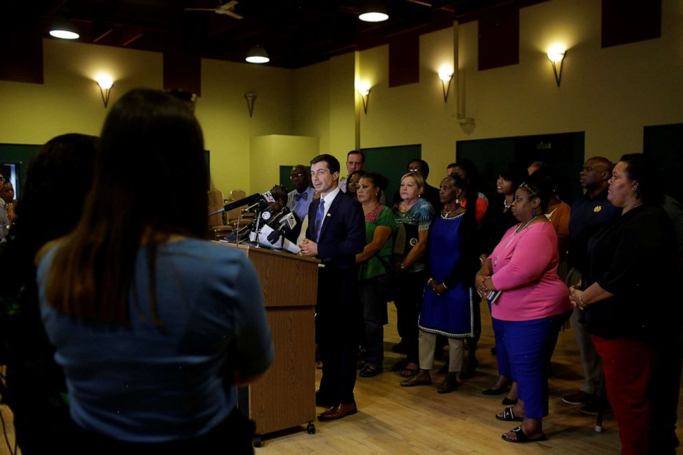 PHOTO: South Bend Mayor and 2020 presidential candidate Pete Buttigieg talks with reporters after meeting with community leaders to discuss policing policies in the community in South Bend, Ind., July 1, 2019.