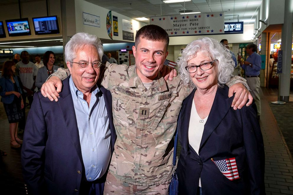 PHOTO: South Bend Mayor Pete Buttigieg with his mother and father after returning from Afghanistan in 2014.