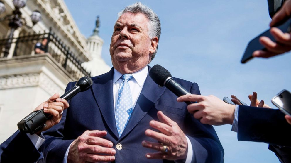 Rep. Peter King talks with reporters at the base of the House steps after the last votes of the week on April 13, 2018.