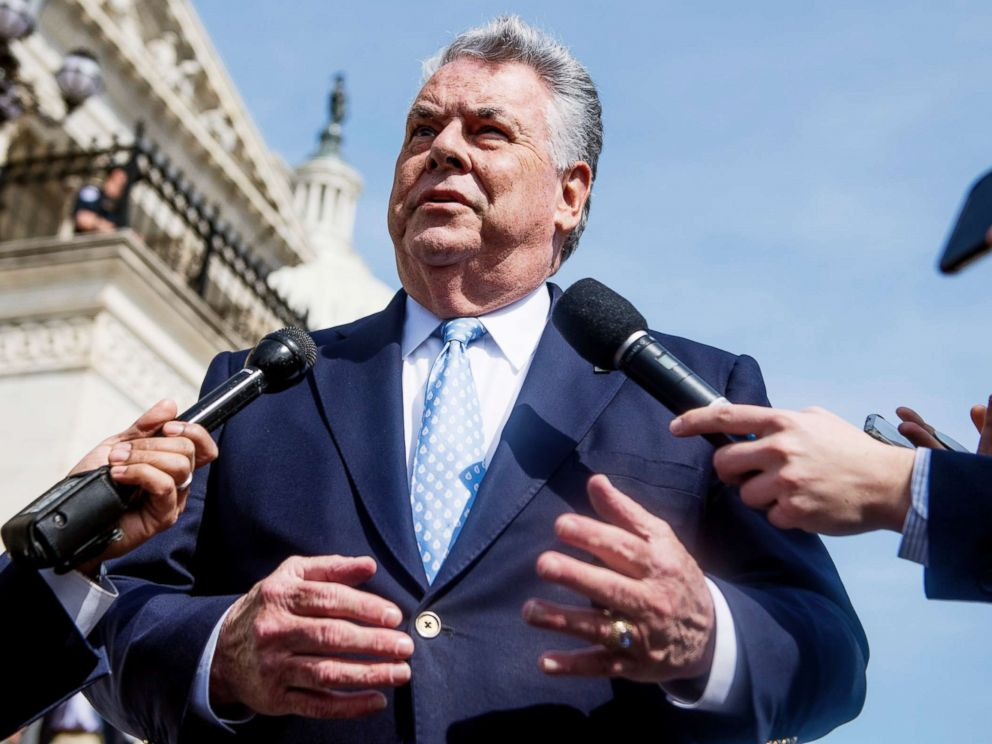 PHOTO: Rep. Peter King talks with reporters at the base of the House steps after the last votes of the week on April 13, 2018.