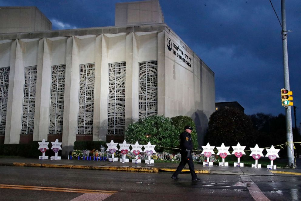 PHOTO: A Pittsburgh Police officer walks past the Tree of Life Synagogue and a makeshift memorial in Pittsburgh, Oct. 28, 2018, in remembrance of those killed and injured when a shooter opened fire during services at the synagogue.