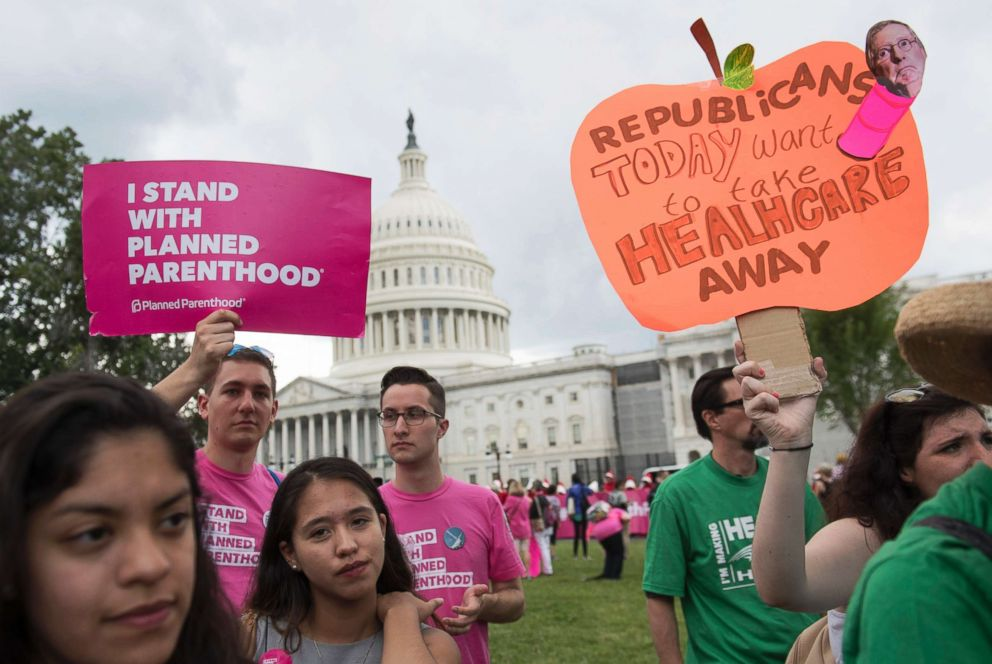 In this file photo, Supporters of Planned Parenthood hold a rally as they protest the US Senate  Republicans' healthcare bill outside the US Capitol in Washington, DC, June 27, 2017.