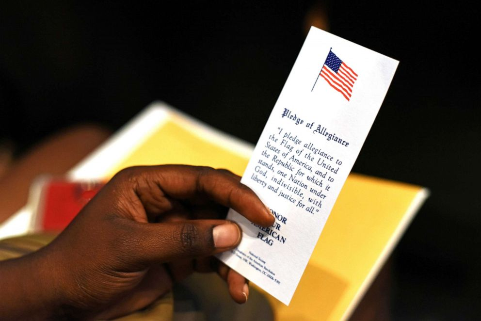 PHOTO: An immigrant holds a copy of the Pledge of Allegiance at her naturalization ceremony in San Antonio, Texas, June 13, 2019.