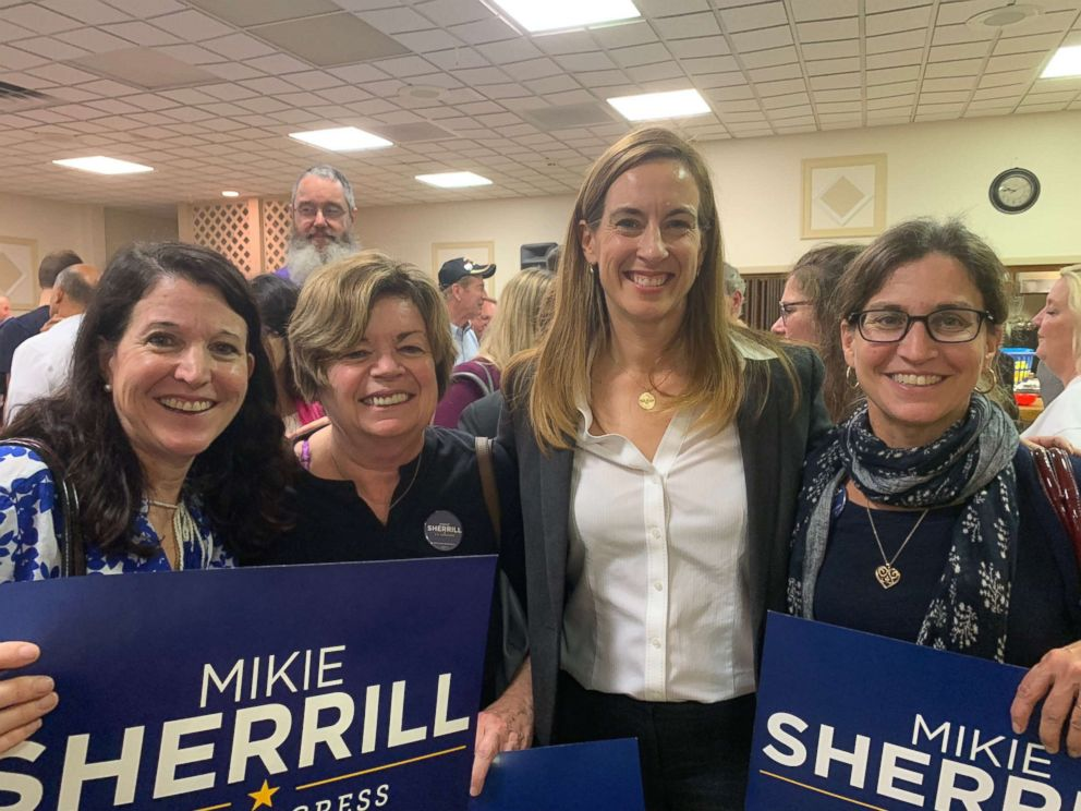 PHOTO: Supporter Dana Pogorzelski, Democratic candidate Mikie Sherrill and supporter Chris Gemici attend a campaign event for Sherrill.