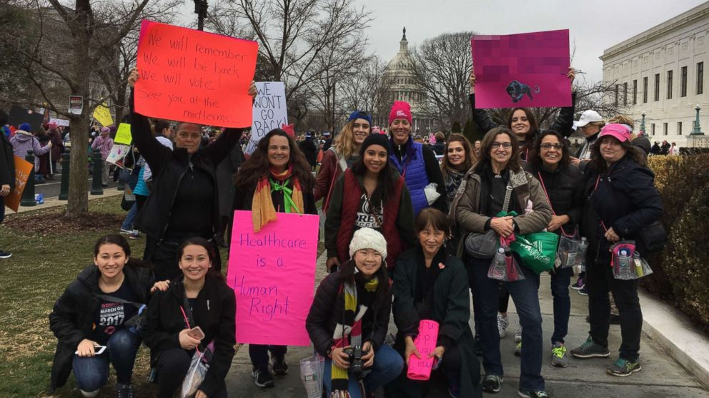 Dana Pogorzelski, fourth from right, a leading member of a grassroots organization in New Jersey called 25/11, poses for a photo with a group of her neighbors at the Women's March in Washington D.C., Jan. 21, 2017.