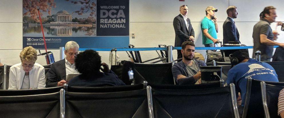 PHOTO: Robert Mueller and Donald Trump Jr. wait at Reagan National Airport outside Washington, D.C., July 27, 2018.