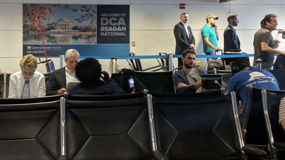 Robert Mueller and Donald Trump Jr. wait at Reagan National Airport outside Washington, D.C., July 27, 2018.