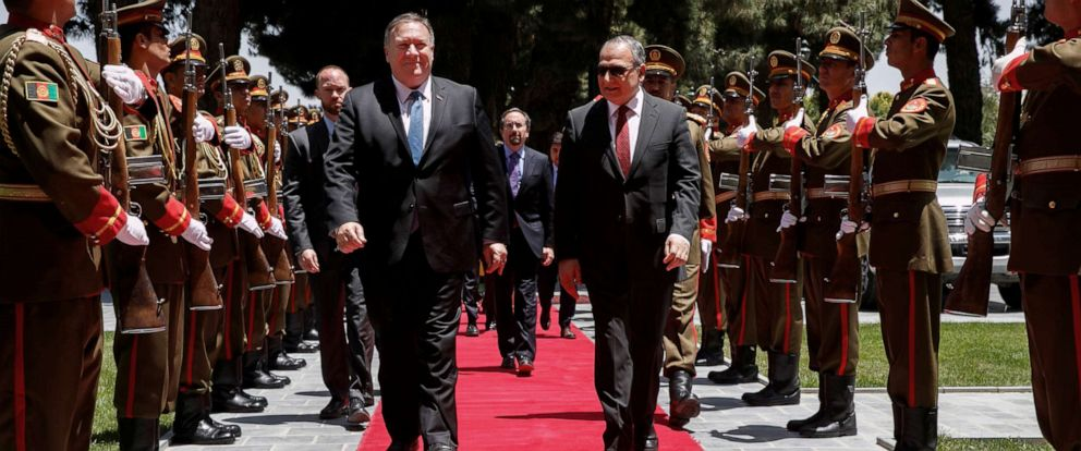 PHOTO: Secretary of State Mike Pompeo walks with Afghan President Ashraf Ghanis Chief of Staff Abdul Salam Rahimi, as he arrives at the Presidential Palace in Kabul, Afghanistan, June 25, 2019.