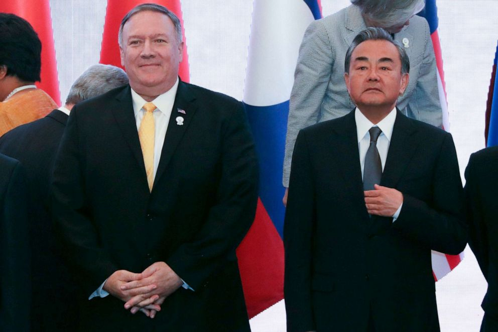 PHOTO: US Secretary of State Mike Pompeo stands next to Chinas Foreign Minister Wang Yi during the 26th Association of Southeast Asian Nations (ASEAN) Regional Forum (ARF) in Bangkok on August 2, 2019.