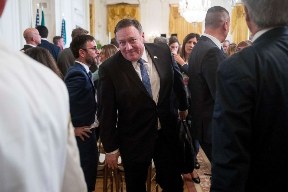 PHOTO: Secretary of State Mike Pompeo, center, departs a news conference with President Donald Trump and Italian Prime Minister Giuseppe Conte in the East Room of the White House, Monday, July 30, 2018.