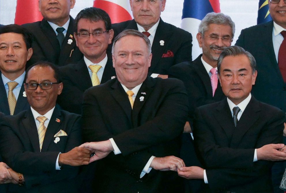 PHOTO: Secretary of State Mike Pompeo crosses his arms for the traditional ASEAN handshake with Chinese Foreign Minister Wang Yi and other fellow diplomats during the 26th ASEAN Regional Forum in Bangkok, Thailand, Aug. 2, 2019.