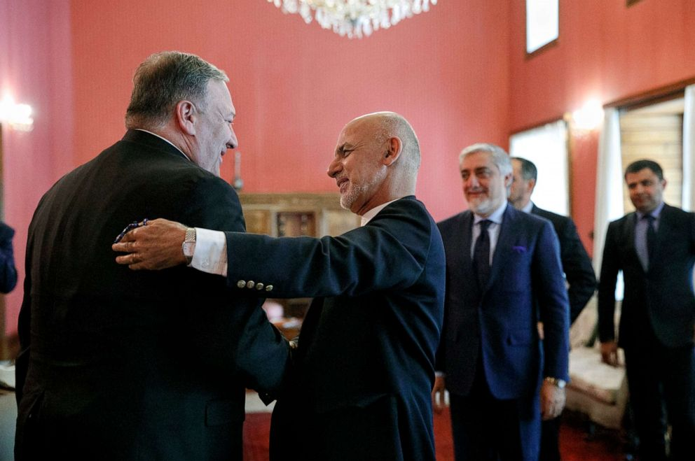 PHOTO: Secretary of State Mike Pompeo, left, is greeted by Afghan President Ashraf Ghani, at the Presidential Palace in Kabul, Afghanistan, June 25, 2019, during an unannounced visit. At right is Afghan Chief Executive Officer Abdullah Abdullah.