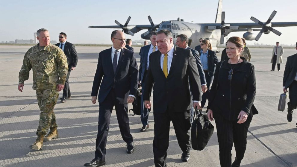 Secretary of State Mike Pompeo, second right, and his wife Susan, right, is welcomed by U.S. ambassador to Iraq Douglas Silliman, second left, as they arrive in Baghdad, Iraq, during a Middle East tour, Jan. 9, 2019.