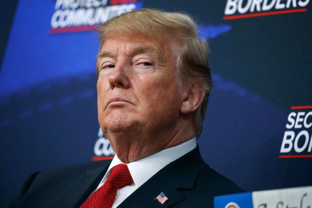PHOTO: President Donald Trump listens during an event on immigration alongside family members affected by crime committed by undocumented immigrants, at the South Court Auditorium on the White House complex in Washington, June 22, 2018.