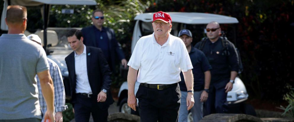 PHOTO: President Donald Trump arrives to play host to members of the U.S. Coast Guard he invited to play golf in West Palm Beach, Florida, Dec. 29, 2017.