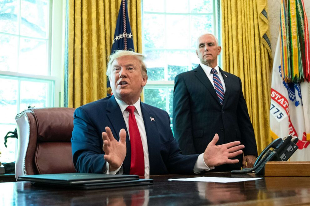 PHOTO: Vice President Mike Pence watches President Donald Trump speak after he signed an executive order for additional sanctions against Iran and its leadership, in the Oval Office at the White House in Washington, June 24, 2019.
