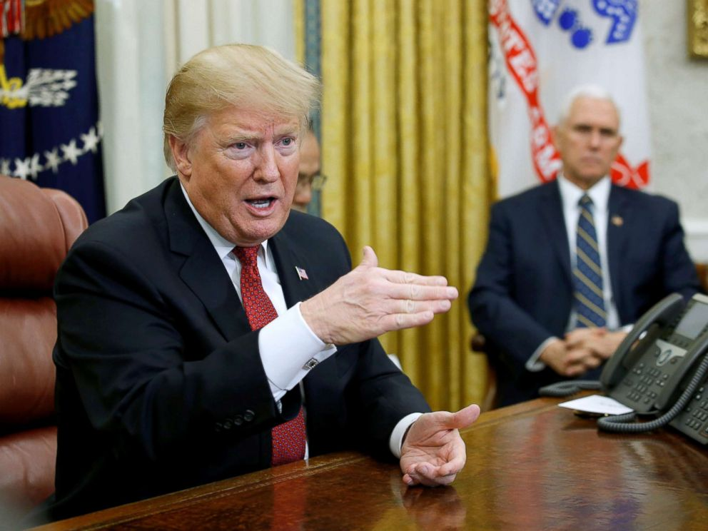 PHOTO: President Donald Trump speaks to Chinas Vice Premier Liu He as Vice President Mike Pence looks on during a meeting in the Oval Office of the White House in Washington, Jan. 31, 2019.