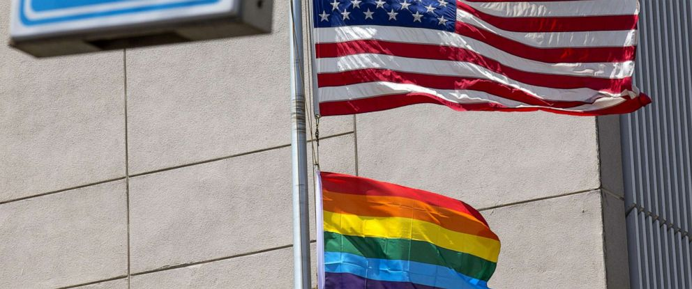 PHOTO: A gay pride flag is raised next to the US flag is at the former US embassy in Tel Aviv, June 13, 2014, in this file photo.