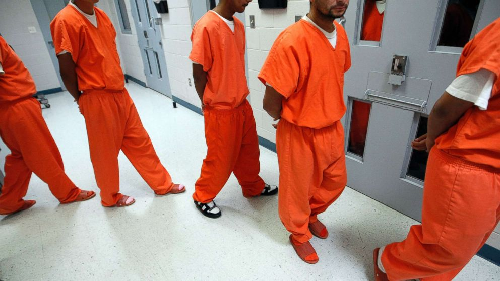 New federal inmates prepare to undergo health screenings while being processed at the Val Verde Correctional Facility in Del Rio, Texas.