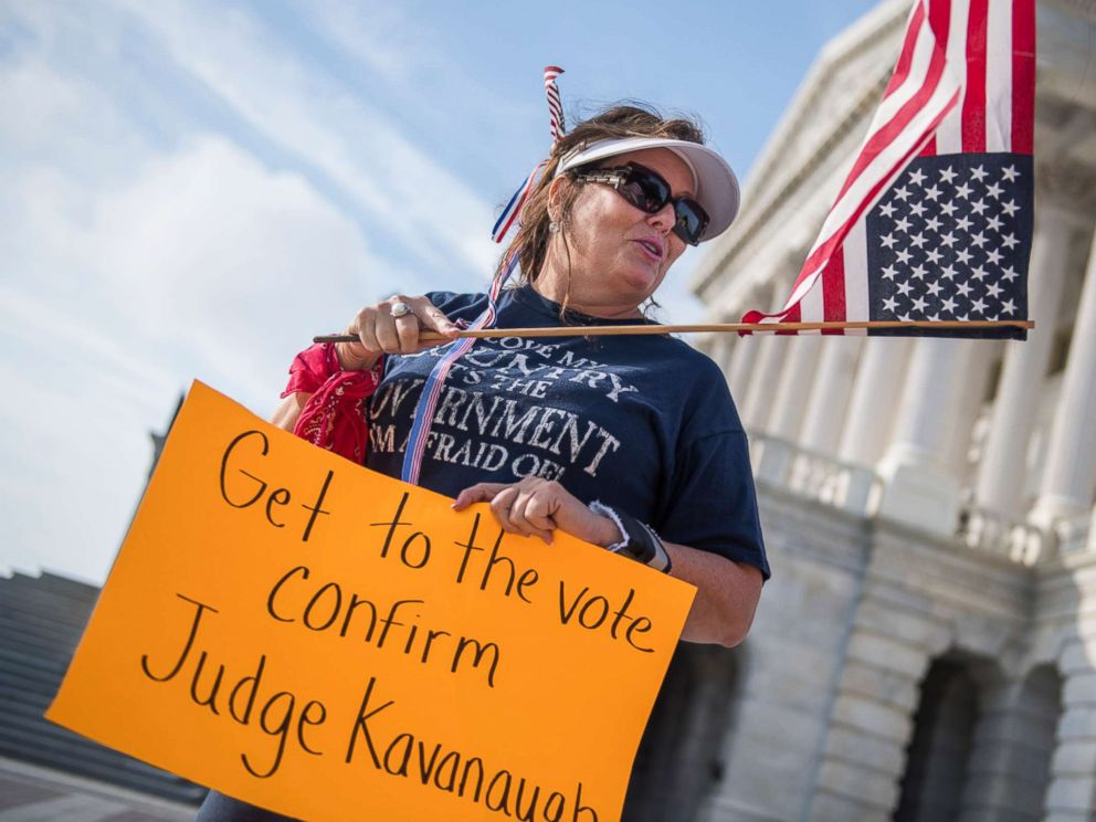 PHOTO: A woman from Virginia Beach shows her support for Supreme Court nominee Brett Kavanaugh on the East Front of the Capitol, as senators review the FBIs supplemental background check on him on Oct. 4, 2018.