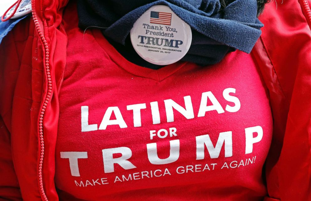 PHOTO: A fan shows off her Latinas for Trump shirt and Trump button, as she waits admittance to a rally with President Donald Trump, Nov. 26, 2018, in Biloxi, Miss.