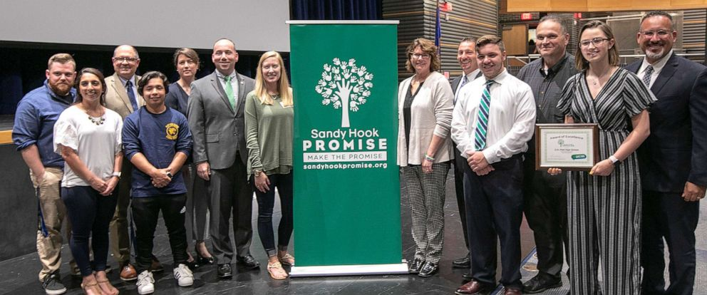 PHOTO: Sandy Hook Promise members, students and city and school officials pose for photos after an award presentation at Platt High School in Meriden, Conn., May 28, 2019.