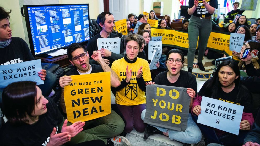 Environmental activists occupy the office of House Democratic Leader Nancy Pelosi of California, the speaker-designate for the new Congress, as they try to pressure Democratic support for a sweeping agenda to fight climate change, on Capitol Hill, Dec. 10, 2018.