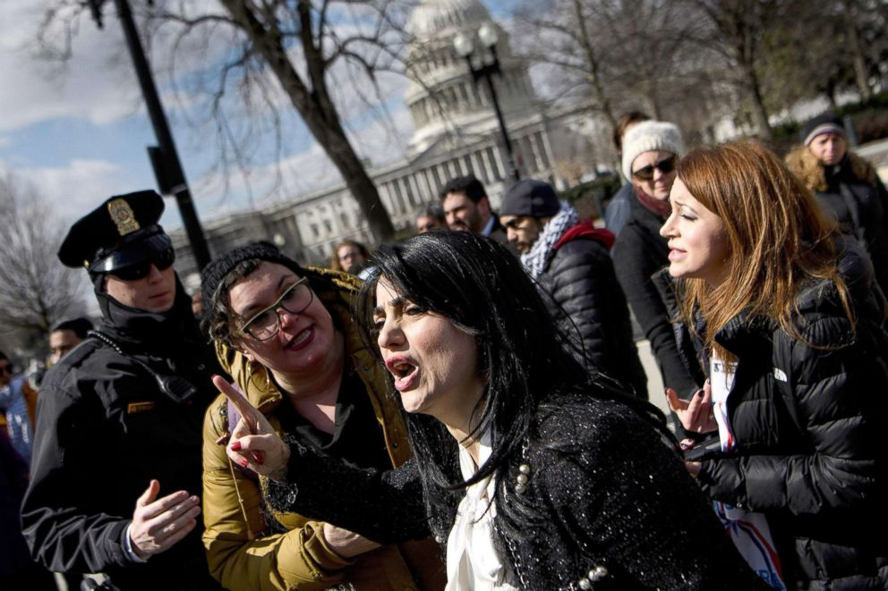 PHOTO: Jewish Voice for Peace Deputy Director Rabbi Alissa Wise, second from left, talks to Rabia Kazan, of the Middle Eastern Womans Collision, as she calls for the resignation of Rep. Ilhan Omar, outside the U.S. Supreme Court, March 6, 2019.