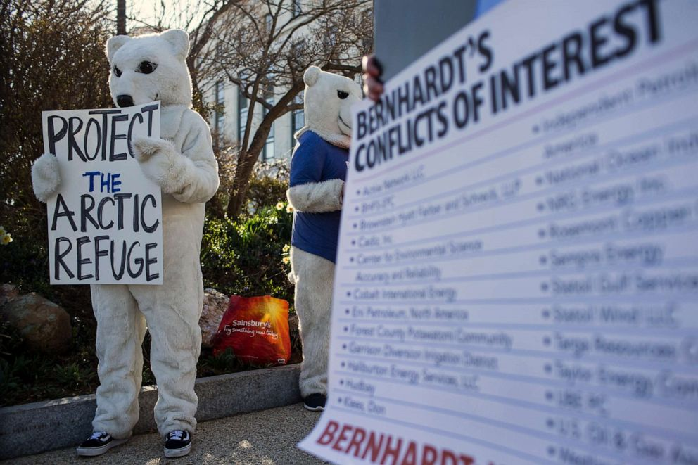 PHOTO: Demonstrators gather outside of the Dirksen Senate Office Building on Capitol Hill ahead of a confirmation hearing for David Bernhardt, President Donald Trumps nominee to be Secretary of the Interior, March 28, 2019, in Washington, D.C.