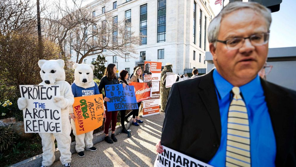 Activists with the consumer rights advocacy group 'Public Citizen' protest the nomination of David Bernhardt to head the Department of the Interior, outside the Dirksen Senate Office Building in Washington, D.C., March 28, 2019.
