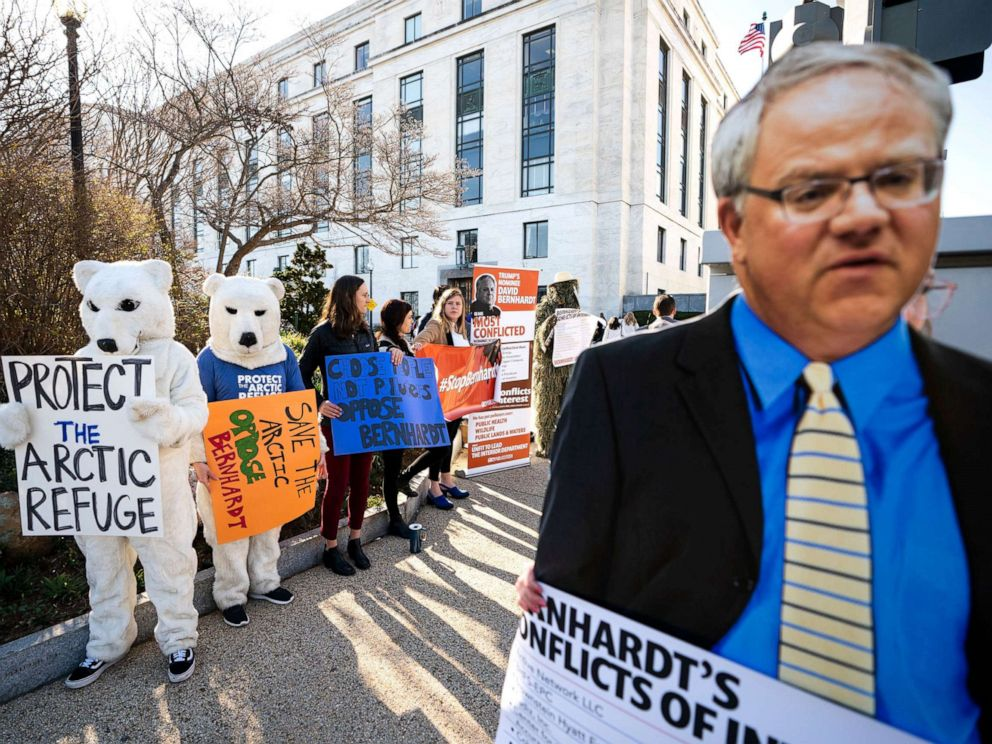 PHOTO: Activists with the consumer rights advocacy group Public Citizen protest the nomination of David Bernhardt to head the Department of the Interior, outside the Dirksen Senate Office Building in Washington, D.C., March 28, 2019.